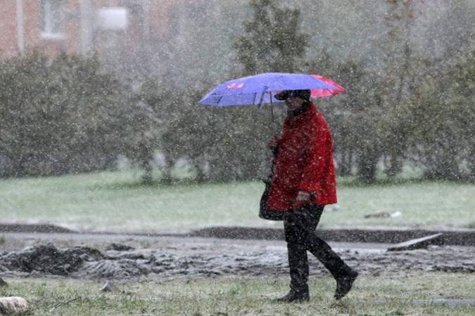 Погода в Украине: балканский циклон несет ливни и мокрый снег