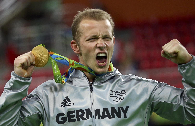 Германец Хамбюхен одержал победу золото наперекладине