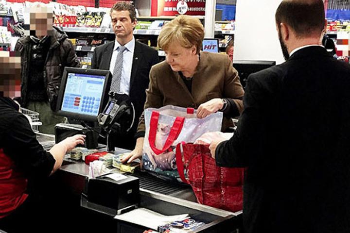 Меркель пошла вмагазин закартошкой сохранниками