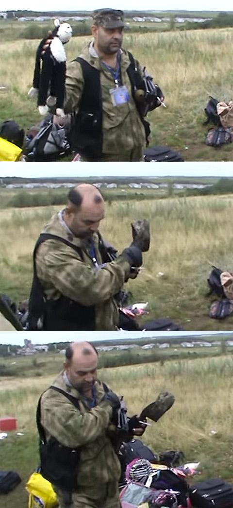 Кадры из видео, в котором ополченец крестится, вспоминая жертв трагедии