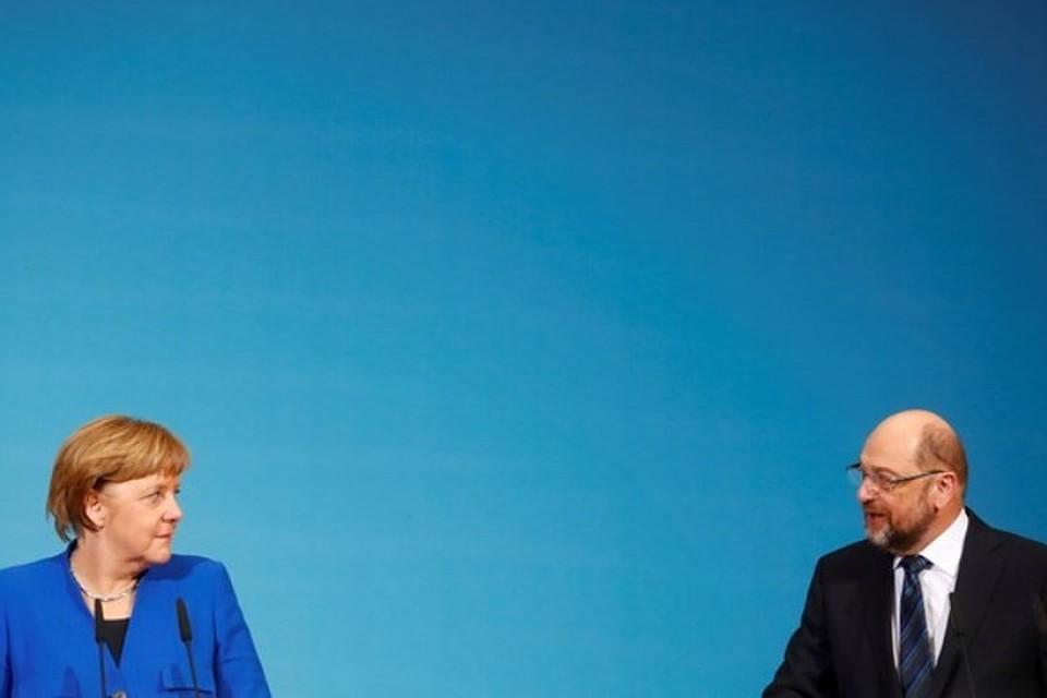 Канцлер ФРГ Ангела Меркель (слева) и лидер Социал-демократической партии Германии Мартин Шульц