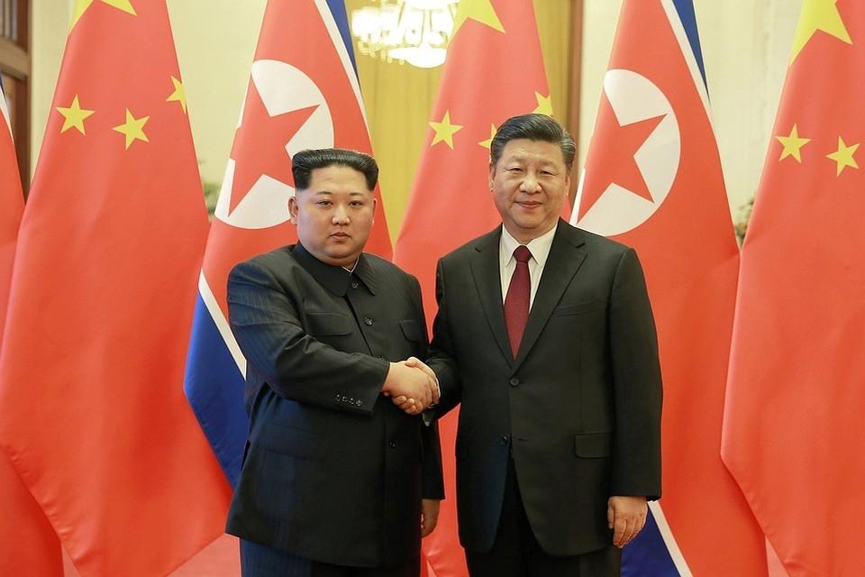 Лидер КНДР Ким Чен Ын и председатель КНР Си Цзиньпин
