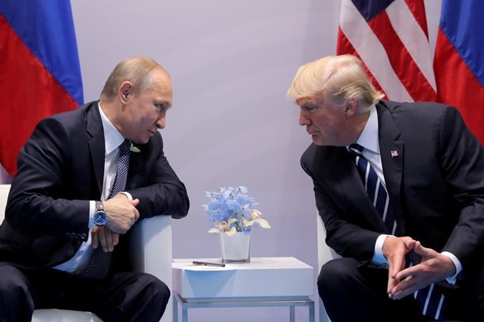Президент России Владимир Путин и американский лидер Дональд Трамп