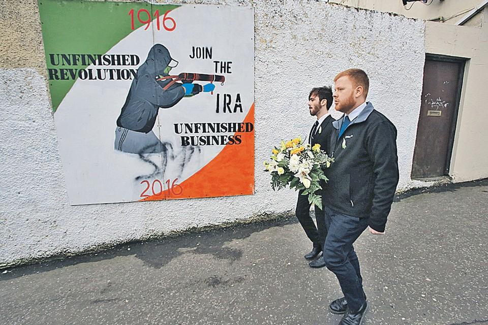 Свежее граффити на стенах североирландского городка Лондондерри: «Незаконченная революция, незаконченное дело - вступайте в Ирландскую республиканскую армию».