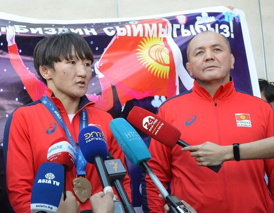 Айсулуу Тыныбекова с тренером.