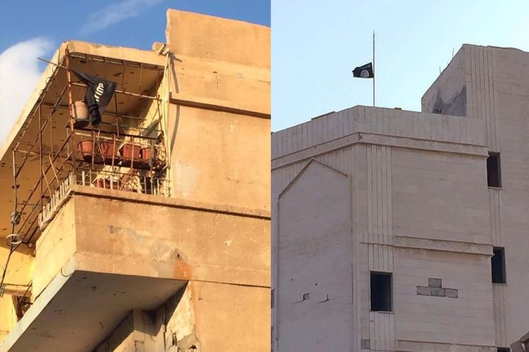 """Солдаты не спешат снимать флаги """"Исламского государства"""" (организация запрещена в России). Здания могут быть заминированы и должны дождаться сапёров."""