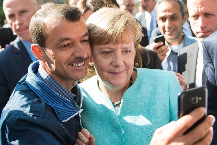 Ангела Меркель в центре приема беженцев из стран Ближнего востока, 2015 год.