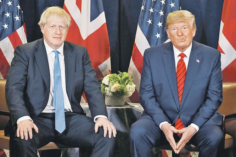 Премьер-министр Великобритании Борис Джонсон (слева) и президент США Дональд Трамп. Обоих ждут нелегкие времена: в 2020 году Великобритании предстоит выходить из Евросоюза, а США выбирать нового президента.