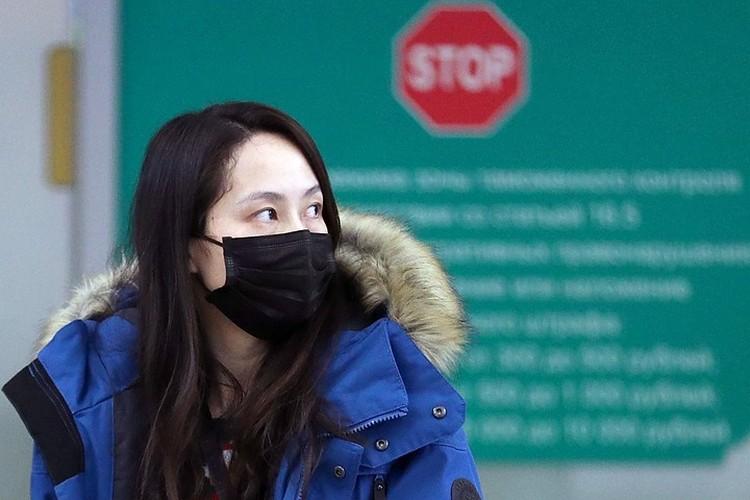 Китайская туристка в столичном аэропорту Шереметьево. Фото: Михаил Терещенко/ТАСС