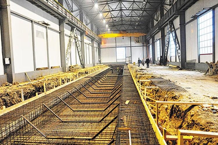 Строительство цеха для производства железобетонных конструкций, применяемых в крупнопанельном домостроении.